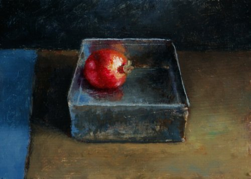 Still life with pommegrenate in box